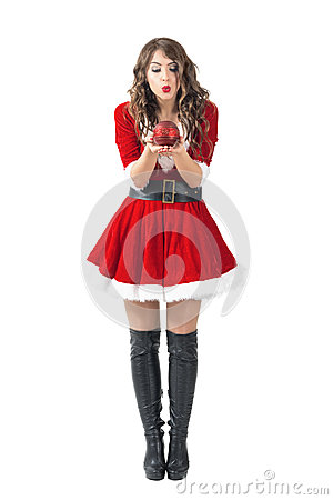 Free Young Santa Girl Blowing Round Decorative Candle Royalty Free Stock Images - 76449799