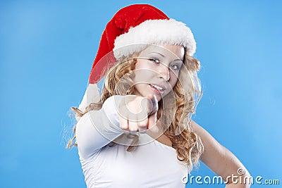 Young Santa woman pointing at you
