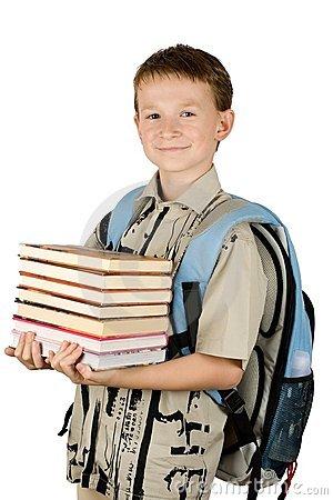 Young school boy holding a books