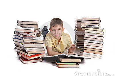 Young school boy reading books