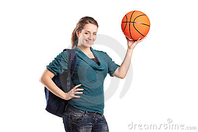 Young school girl holding a basketball