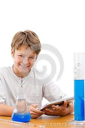 Young science student with tablet doing homework.