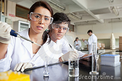 Young science students working