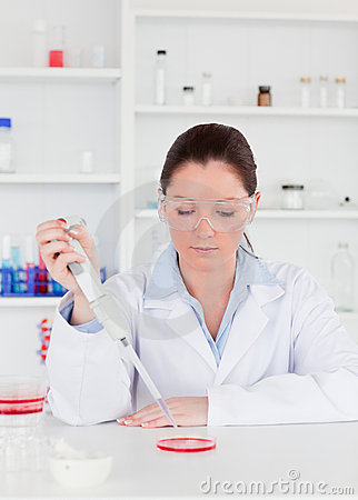 Young scientist preparing a sample