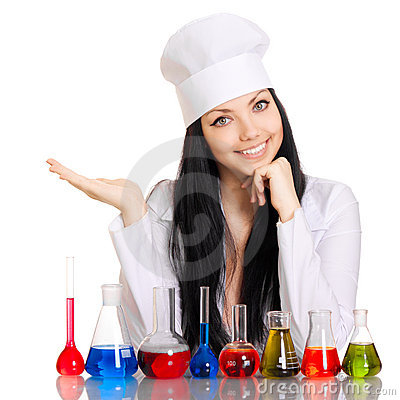 Young scientist at the table with test tubes