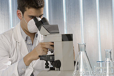 Young scientist working at the microscope