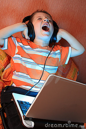 Free Young Screaming Kid With Headphones Stock Image - 13302301