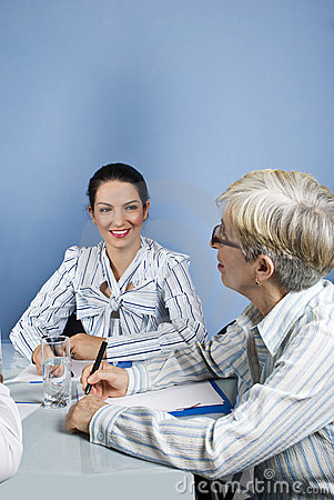 Young and senior business woman conversation