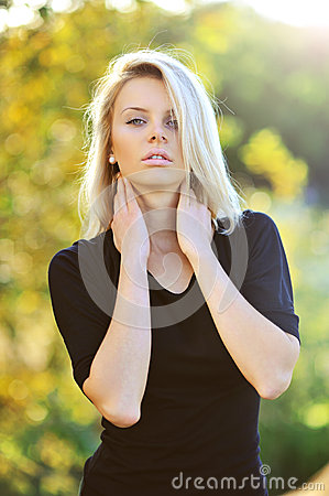 Young sensual female model posing outdoors