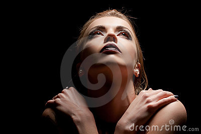Young sensual woman in ray of light