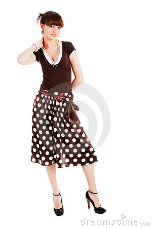 Young  sensuality beautiful girl in spotted skirt