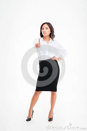 Free Young Serious Beautiful Asian Businesswoman Pointing At Camera Royalty Free Stock Photo - 77190185