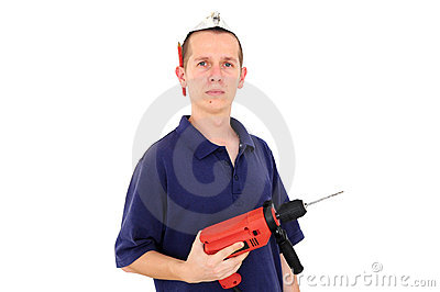 Young serious worker with drill