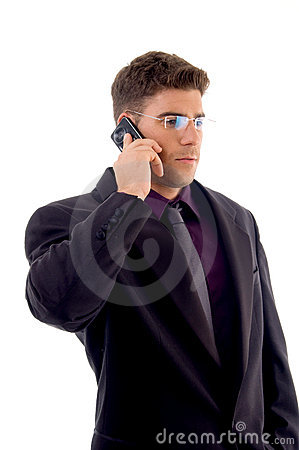 Young service provider communicating on cell phone