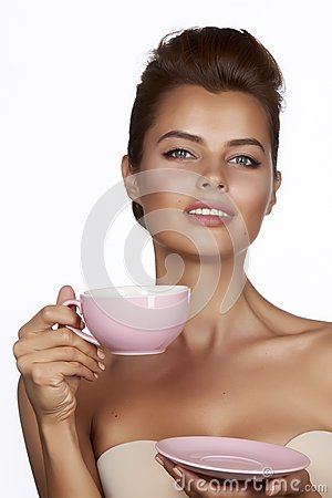 Free Young Sexy Beautiful Woman With Dark Hair Picked Up Holding A Ceramic Cup And Saucer Pale Pink Drink Tea Or Coffee On A White Back Royalty Free Stock Photography - 48916457