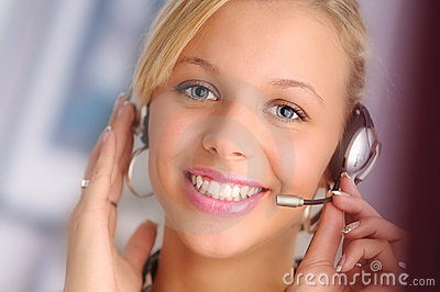 Young sexy blond hair operator with headset