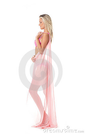 A young and sexy blond posing with a pink blanket