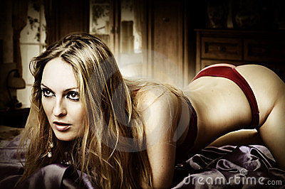 Young sexy blond woman at bedroom