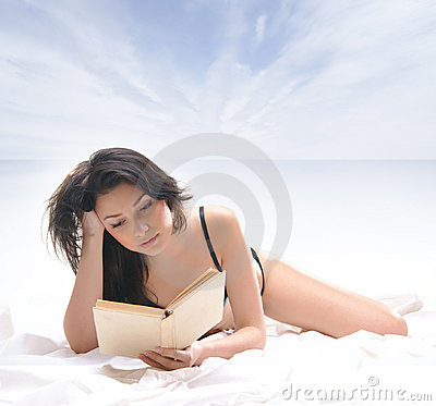 A young and sexy brunette with a book