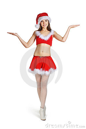 A young and sexy brunette girl in a Santa costume