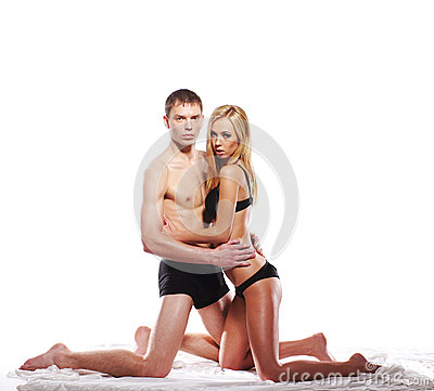 A young and sexy Caucasian couple posing in black lingerie
