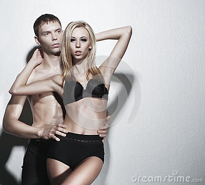 A young and sexy couple posing in black lingerie