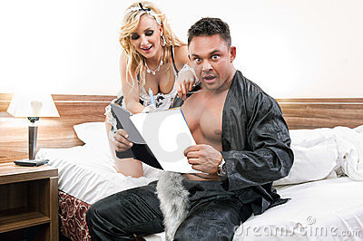 Young sexy couple reading together a magazine