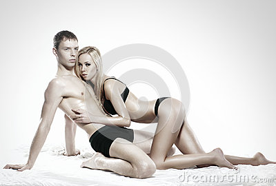 A young and sexy couple relaxing in black lingerie