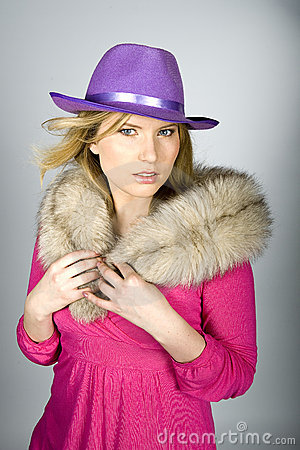 Young sexy elegant woman in a hat
