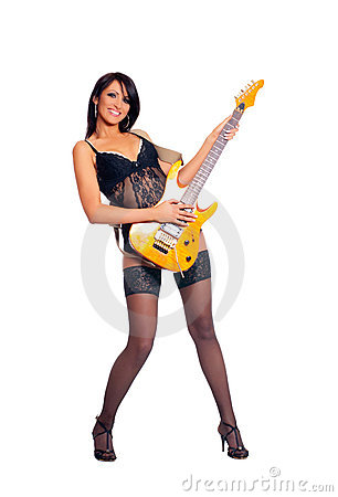 A young and sexy female rockstar with a guitar