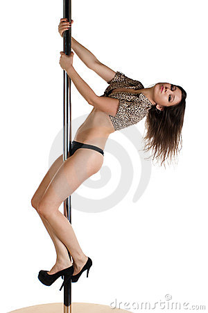 Young sexy girl dancing with the pole