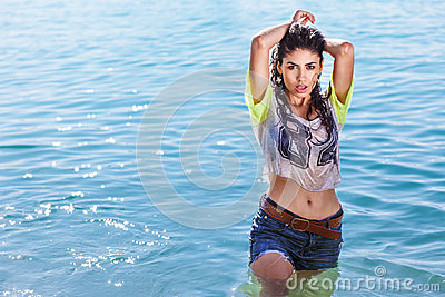 Young sexy girl posing in wet shirt