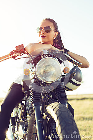 Free Young Sexy Girl Sitting On Vintage Custom Motorcycle And Drinking Juice . Outdoor Lifestyle Portrait Stock Image - 96227891