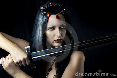 Young sexy girl warrior holding sword
