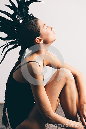 Free Young Sexy Mixed Race Caucasian Woman Vogue Portrait With Feather Mohawk Accessory Wearing Black Bodysuit. Stock Images - 81189434