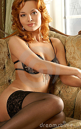 A young and sexy redhead girl in erotic lingerie