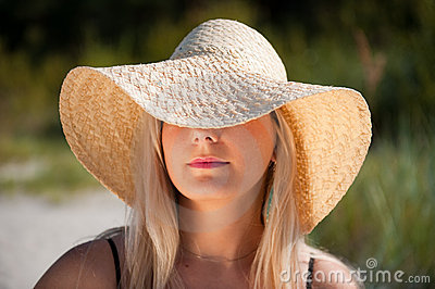 Young sexy summer woman in a hat
