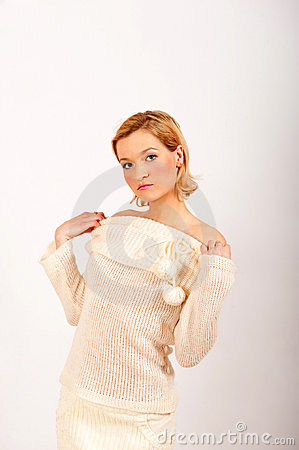 Young sexy winter woman in white knit clothes