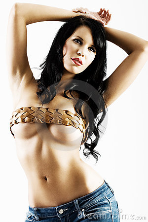 Young sexy woman with belt over breasts