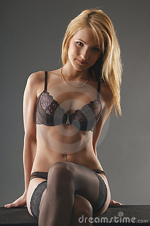 A young and sexy woman in erotic lingerie