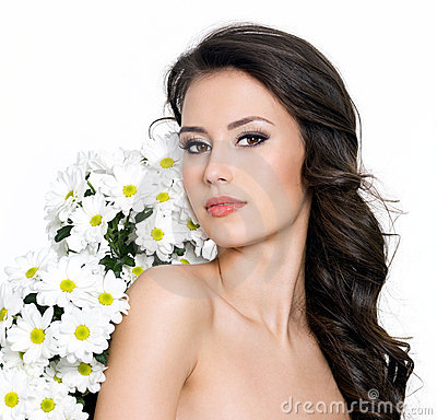 Young sexy woman with flowers