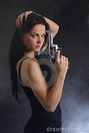 Young and sexy woman holding a gun