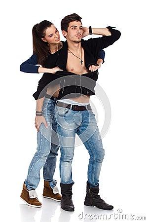 Young sexy woman ripping boyfriend shirt