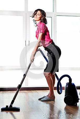Young sexy Woman with Vacuum Cleaner