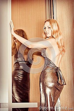 Young sexy woman wearing fashionable dress