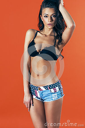 Free Young Sexy Woman Wearing Jeans Shorts. Attractive Brunette Model Royalty Free Stock Image - 51351446