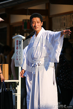 A young shinto priest at Yasaka Shrine in Kyoto Editorial Stock Photo