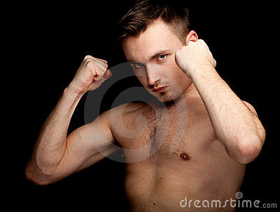 Young shirtless man ready to fight