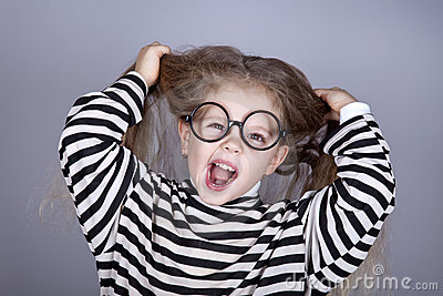 Young shouting child in glasses