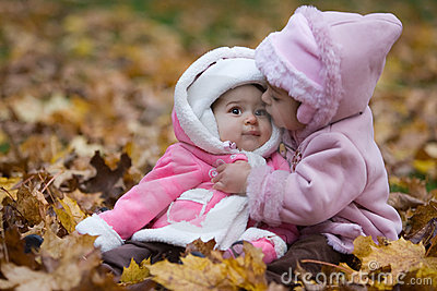 young siblings autumn portrait